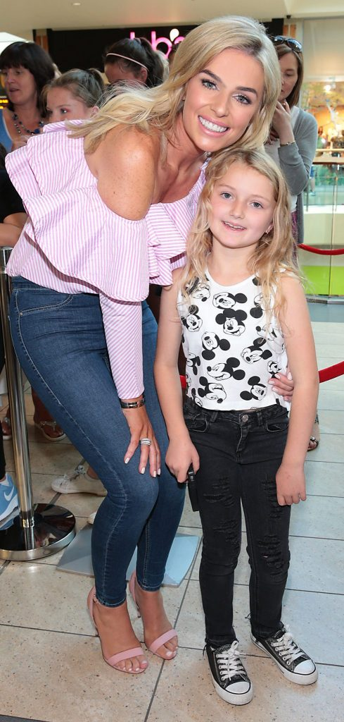 Michaela Flynn Farrell from Douglas ,Cork with Pippa O Connor at the opening of Pippa O Connor's POCO Pop Up Shop at Mahon Point Shopping Centre Cork Pic Brian McEvoy No Repro Fee for one use